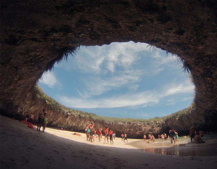 Hole in rock at beach in Puerto Vallarta Mexico