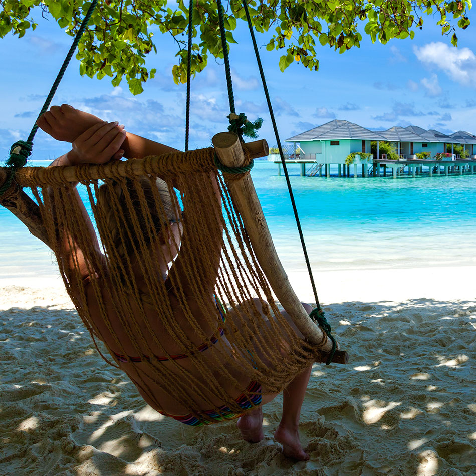 Relaxing in hammock on a Jamaican beach