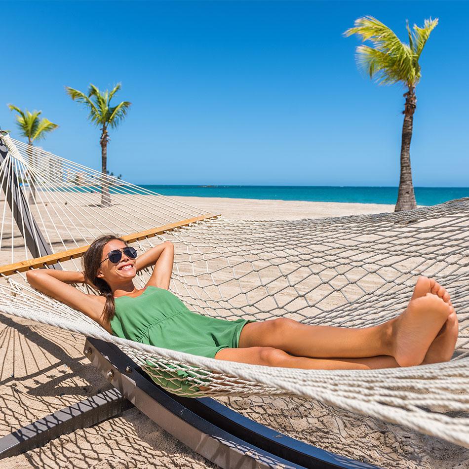 Laying in hammock on a beach in Antigua
