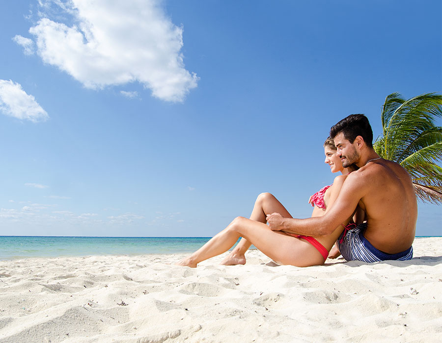 Couple on beach in Cancun Mexico