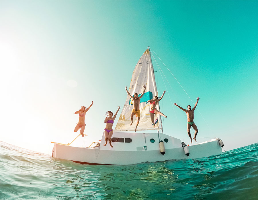 Jumping off sail boat in Jamaica