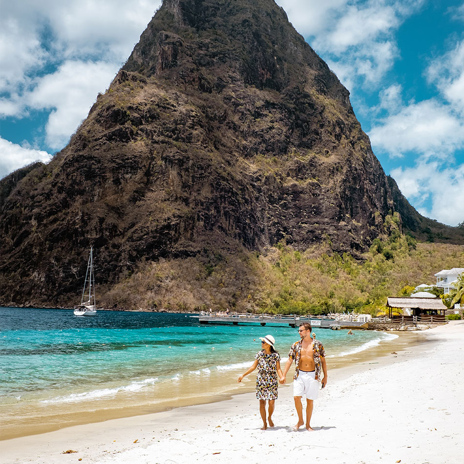Couple walking on the beach in St. Lucia