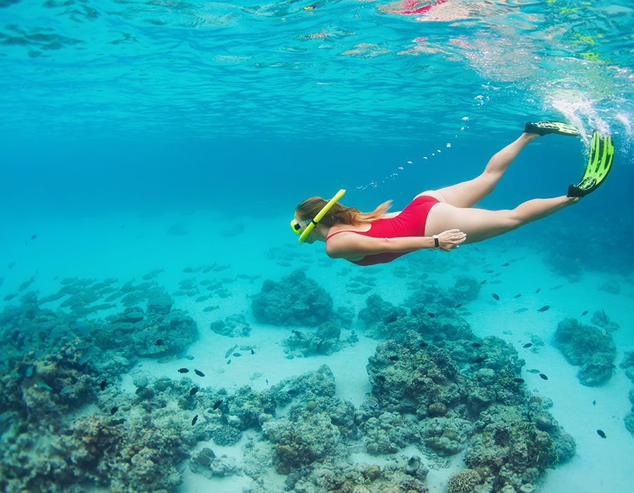 Girl snorkeling in the Bahamas